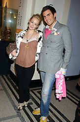 OSCAR HUMPHRIES and ELLIE SHEPHERD at a fashion show and after party to celebrate the 20th Anniversay of fashion designer Ozwald Boateng held at the Victoria & Albert Museum, London on 25th November 2005.<br />