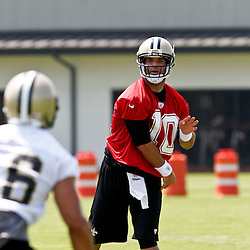 June 6, 2012; Metairie, LA, USA; New Orleans Saints quarterback Chase Daniel (10) throws to wide receiver Lance Moore (16) during a minicamp session at the team's practice facility. Mandatory Credit: Derick E. Hingle-US PRESSWIRE