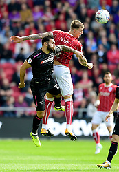 Aden Flint of Bristol City challenges for the ball with  Bradley Johnson of Derby County  - Mandatory by-line: Joe Meredith/JMP - 16/09/2017 - FOOTBALL - Ashton Gate Stadium - Bristol, England - Bristol City v Derby County - Sky Bet Championship
