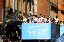 Manchester City goalkeeper Ederson sprays champagne during the trophy parade in Manchester.