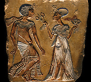 Ancient Egyptian painted relief.' Walk in the garden'. 18th Dynasty, C. 1335 B.C. From Amarna. shows Tutankhamen with an injury of the left leg. Pharaoh of Egypt. Reign; 1391–1353 or  1388–1351 BC,  18th Dynasty