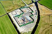 Nederland, Noord-Holland, gemeente Alkmaar, 20-04-2015; bouw Gasopslag Bergermeer door TAQA Energy. Bergen in de achtergrond.<br /> De ondergrondse gasopslag dient om aardgas tijdelijk op te slaan om zo pieken in gebruik op te kunnen vangen. De aanleg is omstreden, mede ivm kans op aardbevingen.<br /> Construction of underground gas storage facility.<br /> <br /> luchtfoto (toeslag op standard tarieven);<br /> aerial photo (additional fee required);<br /> copyright foto/photo Siebe Swart