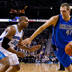 November 17, 2010; New Orleans, LA, USA; Dallas Mavericks power forward Dirk Nowitzki (41) of Germany drives past New Orleans Hornets power forward David West (30) during the first quarter at the New Orleans Arena. Mandatory Credit: Derick E. Hingle