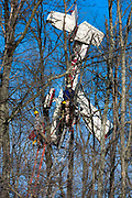 """Crews work on rescuing pilot Herbert Bartell, 87, who was trapped in his plane after it crashed into trees on takeoff and was suspended 50 feet in the air at the Gettysburg Airport on Saturday, Feb. 27, 2016, in Gettysburg, Pennsylvania. Bartell was rescued after a four-hour rescue operation by emergency personnel from across the region. """"I'd go tomorrow if I had a plane,"""" said Bartell to the York Daily Record after the crash when asked if he would fly again. """"it hasn't fazed me one bit."""""""