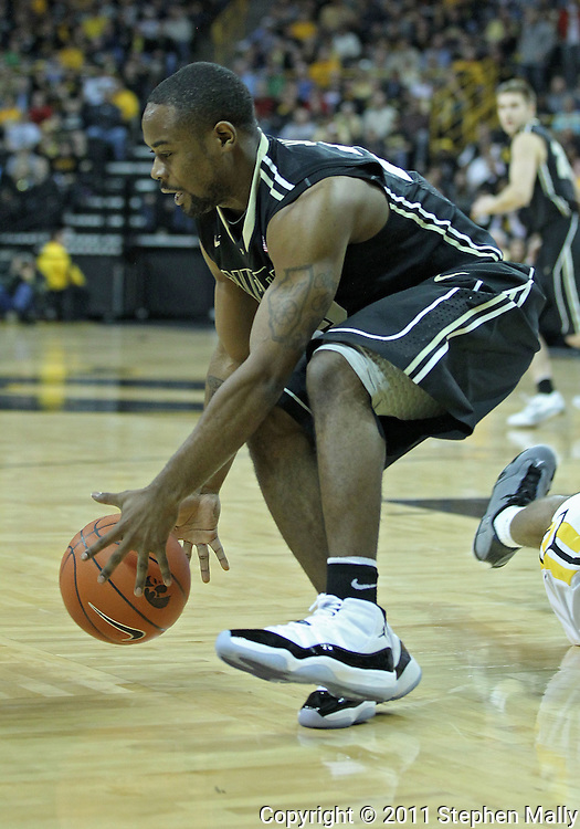 December 28, 2011: Purdue Boilermakers guard Lewis Jackson (23) grabs a lose ball during the NCAA basketball game between the Purdue Boilermakers and the Iowa Hawkeyes at Carver-Hawkeye Arena in Iowa City, Iowa on Wednesday, December 28, 2011. Purdue defeated Iowa 79-76.