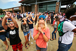 Jack Gable, left, and Andrea Tyler look toward the sky during an Eclipse 2017 Observing Event at Seminole State College on Monday afternoon, Aug. 21, 2017. The Buehler Planetarium at Seminole State College hosted the event and had filtered telescopes and binoculars set up for viewing the eclipse. They also handed out viewing glasses for the first 5,000 visitors. Photo by Jacob Langston/Orlando Sentinel/TNS/ABACAPRESS.COM