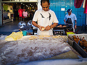 17 NOVEMBER 2016 - GEORGE TOWN, PENANG, MALAYSIA:  Men cook and sell Chinese dough sticks in a marker in George Town, Penang, Malaysia. George Town is a UNESCO World Heritage city and wrestles with maintaining its traditional lifestyle and mass tourism.       PHOTO BY JACK KURTZ