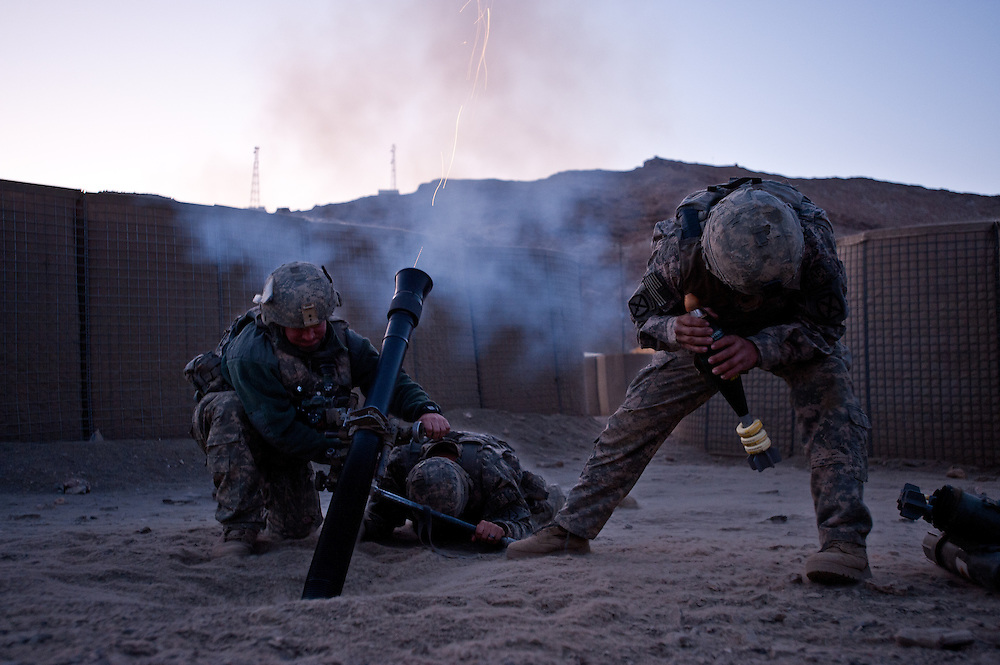 "Mortarmen launch ""harassment and interdiction"" fire at Combat Outpost Apache in the Tangi Valley, home of Apache Company of the 2-87 Infantry Regiment, 3rd Brigade, 10th Mountain Division."