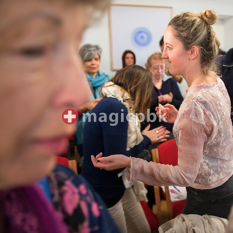Lilleth Palmer-Brown (R, nee Booth) hands out some Pomander during the Aura-Soma Essentials and Essentials Instructor course in Grossgmain near Salzburg, Austria, Thursday, Nov. 26, 2015. (Photo by Patrick B. Kraemer / MAGICPBK)