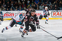 KELOWNA, CANADA - FEBRUARY 1: Kole Lind #16 of the Kelowna Rockets back checks Micheal Zipp #4 of the Calgary Hitmen as he skates up the ice with the puck on February 1, 2017 at Prospera Place in Kelowna, British Columbia, Canada.  (Photo by Marissa Baecker/Shoot the Breeze)  *** Local Caption ***