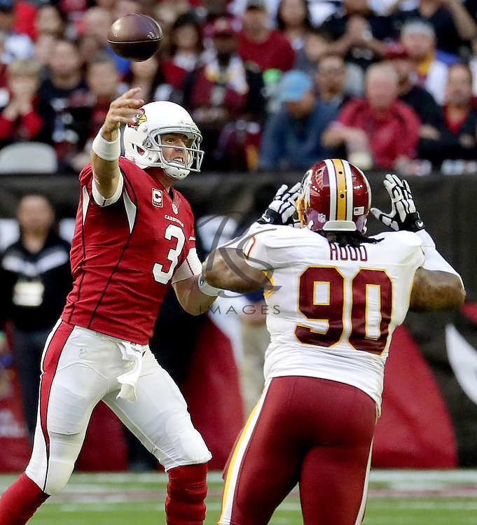 Arizona Cardinals quarterback Carson Palmer (3) throws under pressure from Washington Redskins nose tackle Ziggy Hood (90) during the first half of an NFL football game, Sunday, Dec. 4, 2016, in Glendale, Ariz. (AP Photo/Rick Scuteri)
