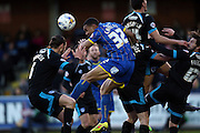 AFC Wimbledon defender Darius Charles (32) attacks a cross during the Sky Bet League 2 match between AFC Wimbledon and Portsmouth at the Cherry Red Records Stadium, Kingston, England on 26 April 2016.