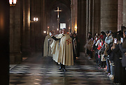 Ceremony of the Veneration of the Crown of Thorns, or Veneration de la Sainte Couronne d'Epines, on Friday 29th March 2019, by the Ordre des Chevaliers du Saint Sepulcre, or the Order of the Knights of the Holy Sepulcher of Jerusalem, guardians of the relics of Christ's Passion since 1920, in the Cathedrale Notre-Dame de Paris, or Notre-Dame cathedral, built 1163-1345 in French Gothic style, on the Ile de la Cite in the 4th arrondissement of Paris, France. The crown of thorns has been held in Paris since 1239 and at Notre-Dame since 1806, along with a piece of the true cross and a nail from the crucifixion. The crown is held in a tubular reliquary of crystal and gold, with a perforated frame depicting a branch of zizyphus or Spina Christi, made by silversmith M Poussielgue-Rusand, 1861-1933, after drawings by J-G Astruc, 1862-1950. The veneration ceremony usually takes place on the first Friday of each month, every Friday of Lent, and on Good Friday. Picture by Manuel Cohen