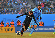 DC United midfielder Paul Arriola (7) controls the ball against New York Football Club defensemen Ben Sweat (2) during the second half of an MLS soccer game at Yankee Stadium in New York, NY, Sunday, March 10, 2019. (Bennett Cohen/image of Sport)