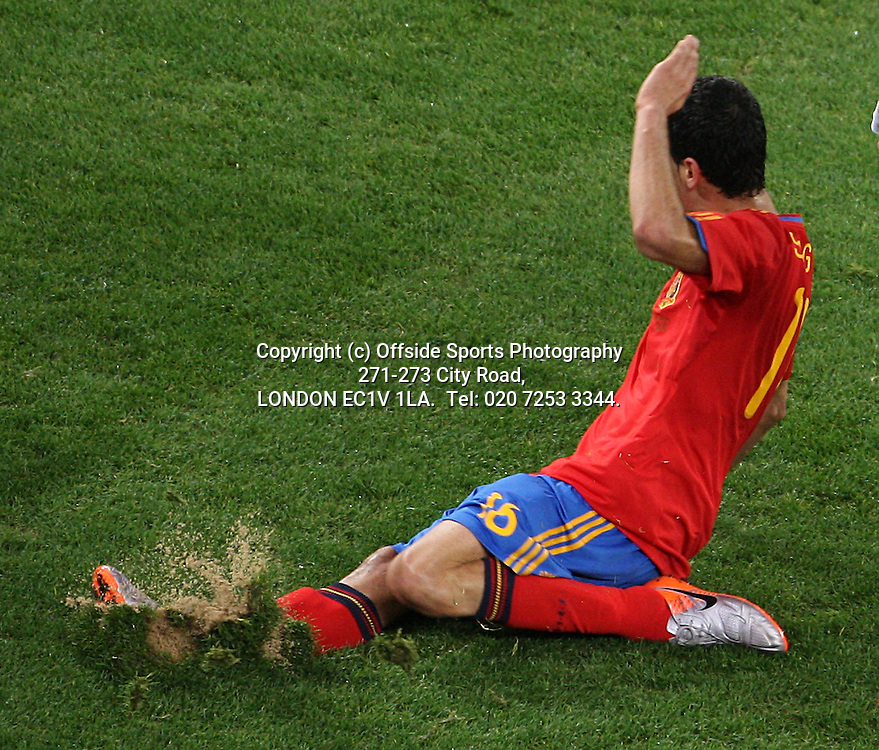 29/06/2010 World Cup. Spain v Portugal.<br /> Sergio Busquets foot slices through the turf of the Green Point pitch.<br /> Photo: Mark Leech.