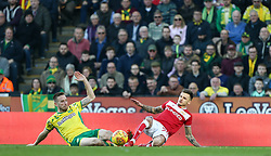 Jamie Paterson of Bristol City goes in t for a tackle with Marco Stiepermann of Norwich City - Mandatory by-line: Arron Gent/JMP - 23/02/2019 - FOOTBALL - Carrow Road - Norwich, England - Norwich City v Bristol City - Sky Bet Championship