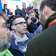 Camera man from Democracy Now argues with a police officer. Police blocking media from working and covering the 'toxic tour'. Activists stage a 'toxic tour' where they try to highlight various companies detrimental affects on the environment and local communities in spite of their green credentials at the Solutions 21 in the Grand Palais COP21 in Paris. COP21 in Paris. The official climate talks in Paris is on and the pressure to come up with a sustainable legally binding is high. In the aftermath of recent terrorist attacks public demonstrations have been banned during the 2 weeks of climate talks