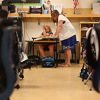 Adam Robison | BUY AT PHOTOS.DJOURNAL.COM<br /> Brenda Bridges, academic interventionist at Pierce Street Elementary School, helps Ryder Vaughn with his work in math class Wednesday afternoon in Tupelo.