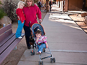 tucsonshooting - 10 JANUARY 2011 - ORO VALLEY, AZ: Denise Cook (CQ) and two of her children, Jaycee Cook (CQ) 18 months, and Nicole Cook, (CQ) 3.5 years, at the entrance to Mesa Verde Elementary School in Oro Valley. Christina Green was a student at the school. Denise has a son in the school and said school counselors met with students Monday morning and told them it was okay to cry for their deceased classmate. She said the students at the school want to do something in Christina's memory.  ARIZONA REPUBLIC PHOTO BY JACK KURTZ..Gabrielle Giffords shooting