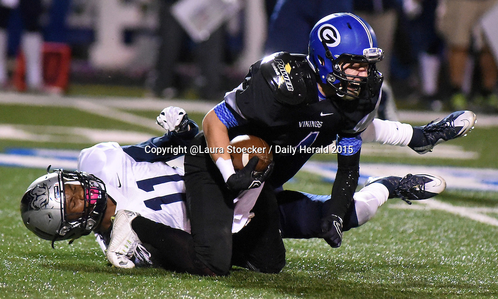 Laura Stoecker/lstoecker@dailyherald.com<br /> Geneva's Ryan Skibinski falls to the ground after completing a pass and getting pushed down by Oswego East's Kaelub Newman in the first half  of playoff game Friday.