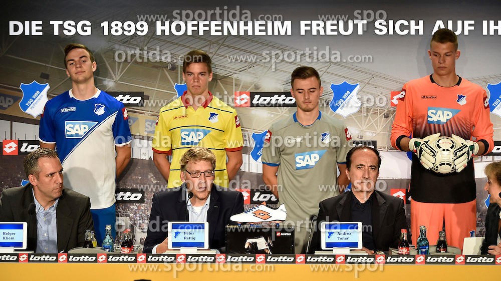 06.07.2014, Wirsol Rhein Neckar Arena, Sinsheim, GER, 1. FBL, TSG 1899 Hoffenheim, Training, im Bild Im Hintergrund neue Trikots, vorne v.li.: Pressesprecher Holger Kliem, Geschaeftsfuehrer Peter Rettig TSG 1899 Hoffenheim Direktor lotto sports Andrea Tomat // during a Trainingssession of German Bundesliga Club TSG 1899 Hoffenheim at the Wirsol Rhein Neckar Arena in Sinsheim, Germany on 2014/07/06. EXPA Pictures &copy; 2014, PhotoCredit: EXPA/ Eibner-Pressefoto/ Weber<br /> <br /> *****ATTENTION - OUT of GER*****