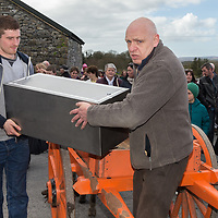 James Kelly and Matthew Egan carry the time capsule into the Church of Ireland Cathedral grounds