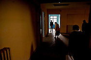 Roma, 16  Novembre  2013. <br /> Famiglie di senza casa,italiani,  immigrati etiopi , eritrei e somali  occupano una ex-scuola abbandonata, a scopo abitativo, al quartiere Centocelle, a Roma.<br /> Rome November 16, 2013<br /> Families  homeless, of  Italians, of immigrants Ethiopians, Eritreans and Somalis occupy a former school abandoned, for housing rights, the district Centocelle in Rome