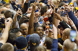 West Virginia Mountaineers guard Juwan Staten (3) celebrates with fans after beating Kansas at the WVU Coliseum.