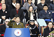 South Korea's new President Park Geun-hye (front L) inspects a honour guard during her inauguration at parliament in Seoul February 25, 2013 as outgoing President Lee Myung-bak (bottom R) looks on. Photo by Lee Jae-Won (SOUTH KOREA)  www.leejaewonpix.com