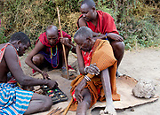 Elderly mambers of a Maasai tribe from Amboseli, kenya, play a local game known as bao.