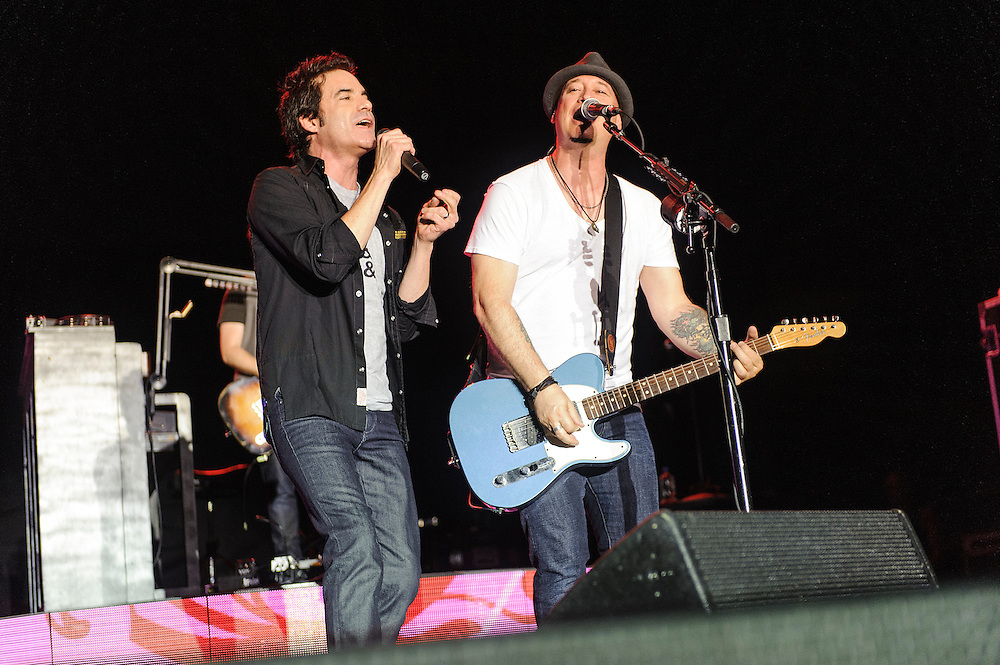 """Photos of the band Train performing live on the """"California 37 World Tour"""" at Central Park SummerStage at Rumsey Playfield, NYC. August 27, 2012. Copyright © 2012 Matthew Eisman. All Rights Reserved."""