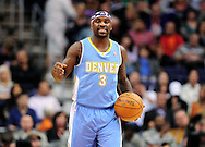 Nov. 12, 2012; Phoenix, AZ, USA; Denver Nuggets guard Ty Lawson (3) dribbles the ball up the court  in the game against the Phoenix Suns at US Airways Center. The Suns defeated the Nuggets 110-100. Mandatory Credit: Jennifer Stewart-USA TODAY Sports