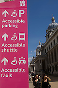 Direction signs and spectators at the old Royal Naval College, Greenwich on day 4 of the London 2012 Olympic Games. Greenwich Park is hosting the Olympic Equestrian competitions, plus the combined running and shooting event of the Modern Pentathlon. The Old Royal Naval College is the architectural centrepiece of Maritime Greenwich, a World Heritage Site in Greenwich, London. The buildings were originally constructed to serve as the Royal Hospital for Seamen at Greenwich, now generally known as Greenwich Hospital, which was designed by Christopher Wren, and built between 1696 and 1712.