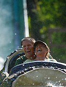 A couple enjoys the log ride at Six Flags Over Texas in Arlington, Texas.