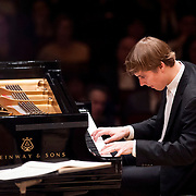 """March 7, 2012 - New York, NY : Pianist Cédric Tiberghien performs Claude Debussy's """"La Cathédrale Engloutie (The Sunken Cathedral)"""" as an encore with the Boston Symphony Orchestra (not pictured) after performing Maurice Ravel's 'Piano Concerto in G Major (1929-1931)' in the Isaac Stern Auditorium at Carnegie Hall on Wednesday night. CREDIT: Karsten Moran for The New York Times"""