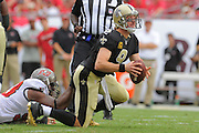 New Orleans Saints quarterback Drew Brees (9) is sacked by Tampa Bay Buccaneers defensive tackle Gerald McCoy (93) during an NFL game at Raymond James Stadium on Sept. 15, 2013 in Tampa, Florida. <br /> &copy;2013 Scott A. Miller