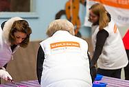 DEN DOLDER  - De prinsessen Beatrix, Aimée en de prinsen Constantijn en Floris hebben vrijdag de handen uit de mouwen gestoken voor de actie NLdoet. De koninklijke vrijwilligers hielpen mee op de Prinses Máxima Manege in Den Dolder.  NL Doet in Den Dolder met o.a. prinses Beatrix, prins Constantijn, prinses Aimee en prins Floris. The princesses Beatrix, Aimée and princes Constantine and Floris on Friday hands invested their sleeves for action NLdoet. The royal volunteers helped the Princess Máxima riding in Den Dolder. COPYRIGHT ROBIN UTRECHT / marco de swart