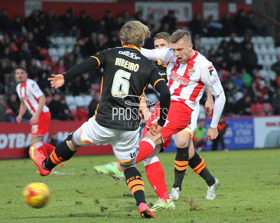 Ryan Brunt fires a shot during the Sky Bet League 2 match between Stevenage and Exeter City at the Lamex Stadium, Stevenage, England on 20 December 2014. Photo by Kieran Clarke.