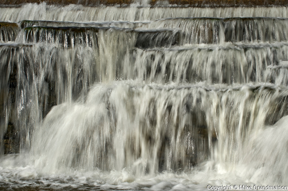 The  Mississippi River cascades over  limestone rocks of small waterfalls<br />