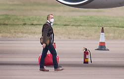 © Licensed to London News Pictures. 31/01/2020. Brize Norton, UK. A passenger disembarks from a charter plane at RAF Brize Norton after being evacuated from Wuhan, China. The flight, carrying 83 Britons and 27 foreign nationals from the centre of the coronavirus outbreak, was initially delayed because of a lack of clearance by Chinese Authorities. The British passengers will travel by coach to a hospital in the north west of England for 14 days quarantine. Photo credit: Peter Macdiarmid/LNP