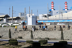 The XXII Winter Olympic Games 2014 in Sotchi, Olympics, Olympische Winterspiele Sotschi 2014<br /> The city of Sochi, workers, Bauarbeiten, Bauarbeiter, construction site, Baustelle, Bausstellen,