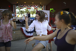 July 3, 2017 - Bloomington, MN, U.S.A - Tiger Tuott, Isabel Taylor, and Jewel Tuott, from left, danced to the music of Pop Rocks Monday evening at the Normandale Lake Bandshell.   ]  JEFF WHEELER • jeff.wheeler@startribune.com ....The City of Bloomington held their annual Summer Fete Monday evening, July 3, 2017 at Normandale Lake Park, capping it off with a fireworks display (Credit Image: © Jeff Wheeler/Minneapolis Star Tribune via ZUMA Wire)