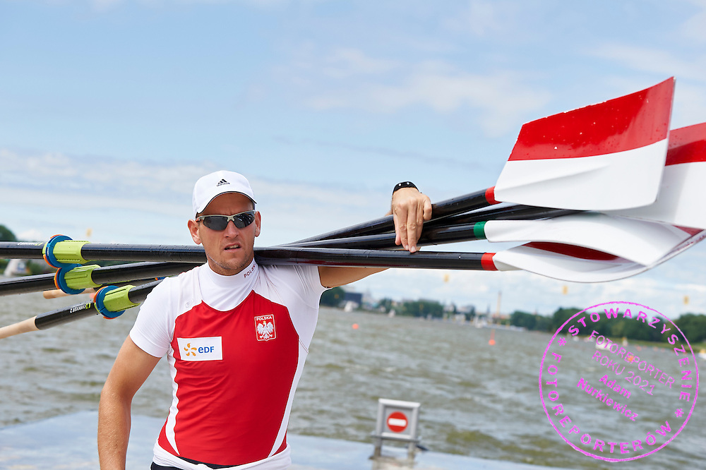 Piotr Hojka holds oars during second day the 2015 European Rowing Championships on Malta Lake on May 30, 2015 in Poznan, Poland<br /> Poland, Poznan, May 30, 2015<br /> <br /> Picture also available in RAW (NEF) or TIFF format on special request.<br /> <br /> For editorial use only. Any commercial or promotional use requires permission.<br /> <br /> Mandatory credit:<br /> Photo by &copy; Adam Nurkiewicz / Mediasport