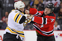 Jan 4, 2012; Newark, NJ, USA; New Jersey Devils right wing Cam Janssen (25) and Boston Bruins right wing Shawn Thornton (22) fight during the first period at the Prudential Center.