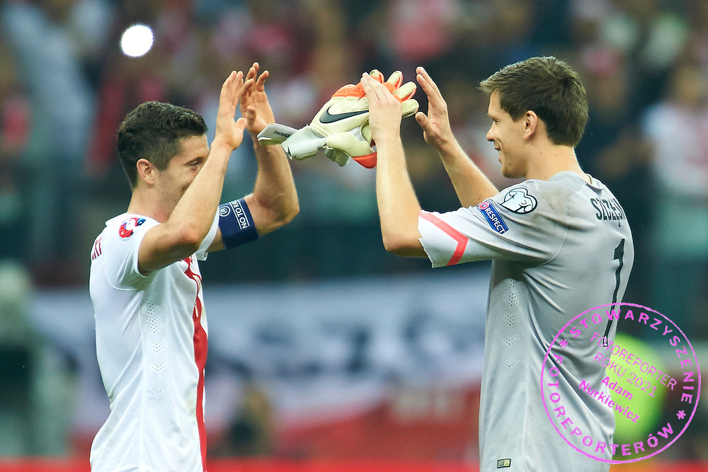 Poland's Robert Lewandowski (L) and Poland's goalkeeper Wojciech Szczesny celebrates after victory during the EURO 2016 qualifying match between Poland and Germany on October 11, 2014 at the National stadium in Warsaw, Poland<br /> <br /> Picture also available in RAW (NEF) or TIFF format on special request.<br /> <br /> For editorial use only. Any commercial or promotional use requires permission.<br /> <br /> Mandatory credit:<br /> Photo by &copy; Adam Nurkiewicz / Mediasport