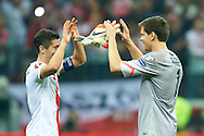 Poland's Robert Lewandowski (L) and Poland's goalkeeper Wojciech Szczesny celebrates after victory during the EURO 2016 qualifying match between Poland and Germany on October 11, 2014 at the National stadium in Warsaw, Poland<br /> <br /> Picture also available in RAW (NEF) or TIFF format on special request.<br /> <br /> For editorial use only. Any commercial or promotional use requires permission.<br /> <br /> Mandatory credit:<br /> Photo by © Adam Nurkiewicz / Mediasport