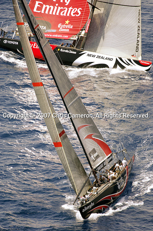 Emirates Team New Zealand NZL92 crosses behind Alinghi SUI100 on the first beat in race two of the 32nd America`s Cup in Valencia, Spain on Sunday 24 June 2007. Team New Zealand won the match by 28 seconds. Photo : Chris Cameron/PHOTOSPORT