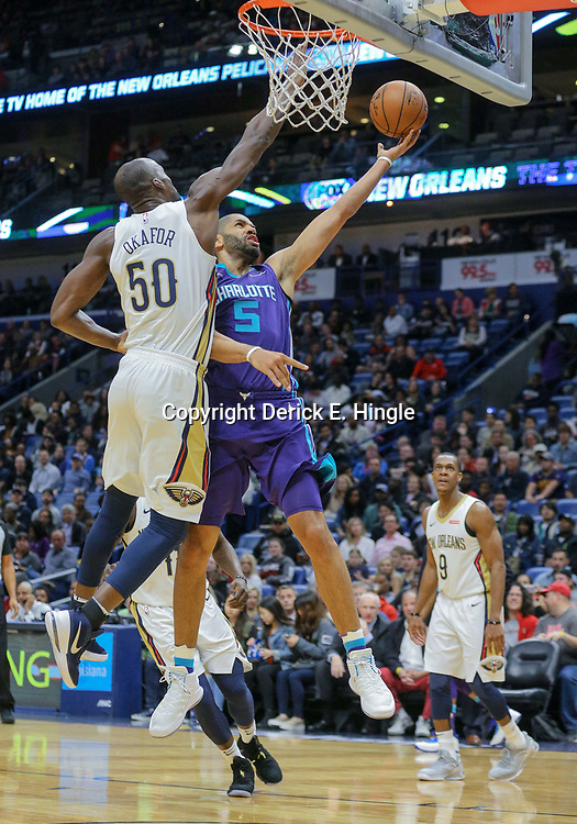 Mar 13, 2018; New Orleans, LA, USA; Charlotte Hornets guard Nicolas Batum (5) shoots over New Orleans Pelicans center Emeka Okafor (50) during the first quarter of a game at the Smoothie King Center. Mandatory Credit: Derick E. Hingle-USA TODAY Sports