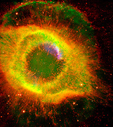 Six hundred and fifty light-years away in the constellation Aquarius, a dead star about the size of Earth, is refusing to fade away peacefully. In death, it is spewing out massive amounts of hot gas and intense ultraviolet radiation, creating a spectacular object called a 'planetary nebula.' Hubble Space Telescope (HST), Spitzer Space Telescope.