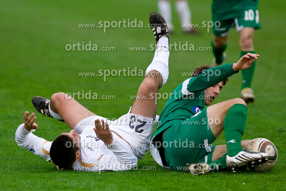 Matija Sirok of Gorica vs Boban Jovic of Olimpija  at 29th Round of 1st Slovenian football league match between NK Olimpija Ljubljana and HIT Gorica, on April 3, 2010, in ZAK stadium, Ljubljana, Slovenia. Olimpija defeated HIT Gorica 5-0.  (Photo by Vid Ponikvar / Sportida)